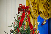 """The 2016 White House Christmas decorations are previewed for the press at the White House in Washington, DC on Tuesday, November 29, 2016. This is a ribbon on top of one of the Christmas Trees in the East Room. The first lady's office released the following statement to describe those decorations, """"This year's holiday theme, 'The Gift of the Holidays,' reflects on not only the joy of giving and receiving, but also the true gifts of life, such as service, friends and family, education, and good health, as we celebrate the holiday season.""""<br /> Credit: Ron Sachs / CNP"""