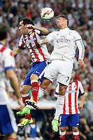 Cristiano Ronaldo of Real Madrid and Godin of Atletico de Madrid during La Liga match between Real Madrid and Atletico de Madrid at Santiago Bernabeu stadium in Madrid, Spain. September 13, 2014. (ALTERPHOTOS/Caro Marin)