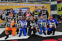 Sept. 16, 2011; Concord, NC, USA: NHRA top fuel dragster championship contender drivers (front row from left) Spencer Massey , Antron Brown , Del Worsham , Brandon Bernstein , Shawn Langdon (back row from left) Larry Dixon , Tony Schumacher , Doug Kalitta , Morgan Lucas and David Grubnic pose for a group photo during qualifying for the O'Reilly Auto Parts Nationals at zMax Dragway. Mandatory Credit: Mark J. Rebilas-