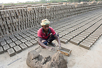 Bangladesh, Jhenaidah. Man making bricks in brick factory.