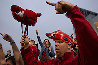 Arkansas Democrat-Gazette/BENJAMIN KRAIN --12/29/2014--<br /> Erik Walther CQ, from Fayetteville, cheers Razorback team members as they enter RNG Stadium in Houston before Monday night's Texas Bowl.
