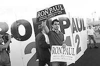 Mesa, Arizona. February 23, 2012 - As Republican candidates debated in the Mesa Arts Center, protesters including undocumented students, tea partiers, occupy movement members and Syrian president opponents, shouted slogans and held up signs and placards outside. In this photograph, a supporter of U.S. Republican presidential candidate Ron Paul demonstrates outside the complex where Paul debated with Mitt Romney, Rick Santorum, and Newt Gingrich. Photo by Eduardo Barraza © 2012