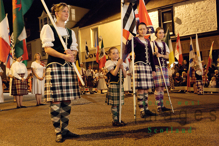 Kirkcudbright Tattoo Scotland UK young highland dancers with flags of all the different nations