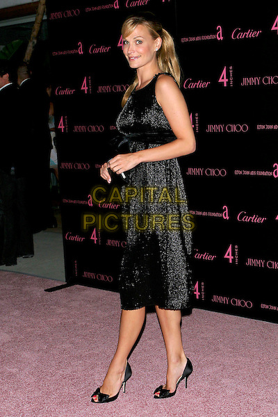 "MOLLY SIMS.""4 Inches - A project for women, about women, by women"" Book Launch and photographic auction to benefit the Elton John Aids Foundation held at Morton's, West Hollywood, CA, USA, .21 June 2005..full length black dress peep toe stilettoes shoes bow.Ref: ADM.www.capitalpictures.com.sales@capitalpictures.com.©Jacqui Wong/AdMedia/Capital Pictures."
