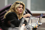 Nevada Assemblywoman Michelle Fiore, R-Las Vegas, works in committee during the final day of the 77th Legislative session at the Legislative Building in Carson City, Nev., on Monday, June 3, 2013. (AP Photo/Cathleen Allison)