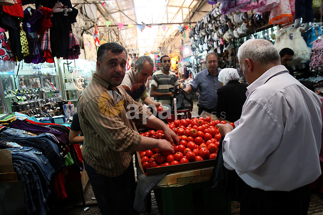 Palestinians shop for vegetables at a market in the West Bank city of Nablus, on Aug. 10, 2011. Muslims around the world are observing the holy fasting month of Ramadan where they refrain from eating, drinking, smoking from dawn to dusk.  Photo by Wagdi Eshtayah