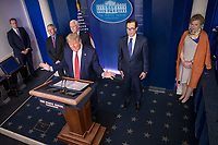 United States President Donald J. Trump delivers remarks on the COVID-19 (Coronavirus) pandemic alongside Vice President Mike Pence and members of the Coronavirus Task Force in the Brady Press Briefing Room at the White House in Washington, DC, March 25, 2020, in Washington, D.C. Standing behind the President, from left to right: Director of the National Institute of Allergy and Infectious Diseases at the National Institutes of Health Dr. Anthony Fauci; US Vice President Mike Pence; US Secretary of the Treasury Steven T. Mnuchin; Dr. Deborah L. Birx, White House Coronavirus Response Coordinator.<br /> Credit: Sarah Silbiger / Pool via CNP/AdMedia