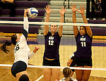 SIOUX FALLS, SD - SEPTEMBER 19:  Michelle Ritland #12 and Lexi Scott #11 from the University of Sioux Falls team up for a block against Ivy Pearson #16 from Augustana during their match Saturday afternoon at the Stewart Center. (Photo by Dave Eggen/Inertia)