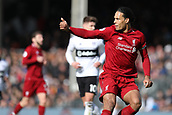 17th March 2019, Craven Cottage, London, England; EPL Premier League football, Fulham versus Liverpool; Virgil van Dijk of Liverpool gives his team mates the thumbs up
