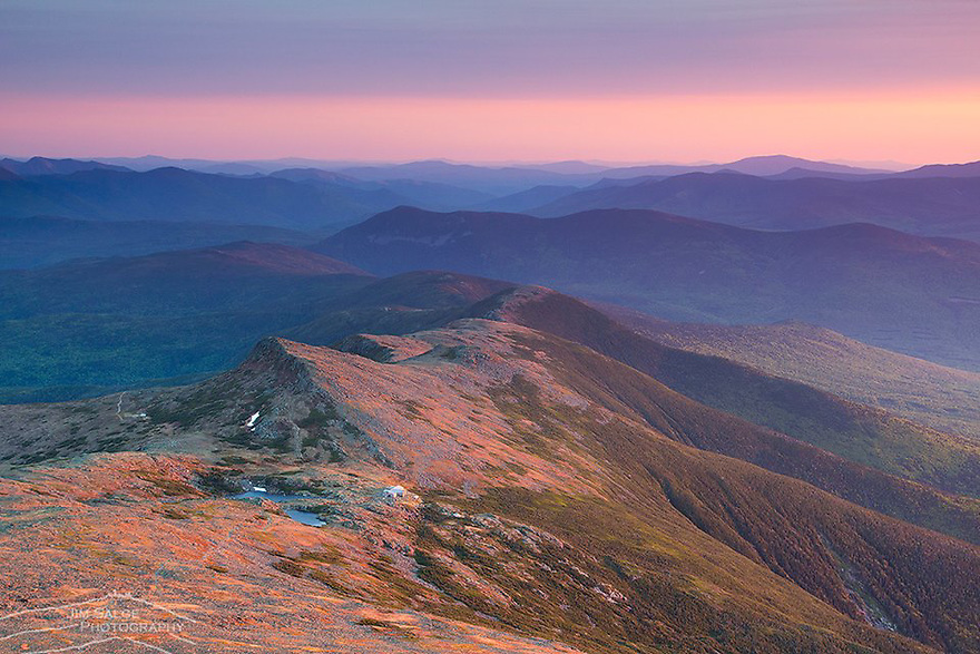 Lakes of the Clouds AMC Hut sits below the summit of Mount Washinton in New Hampshires White Mountains. Sunset light illuminates the Southern Ridges of the Presidential Range along the Appalachian Trail.