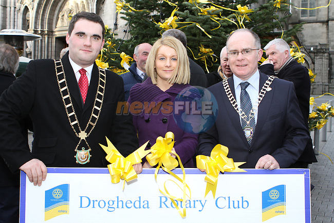 Mayor Kevin Callan, Karen Smyth from the Drogheda Homeless Aid and Drogheda Rotary President Donagh O'Brien at the Launch of the Rotary Tree on West Street....(Photo credit should read Jenny Matthews www.newsfile.ie)....This Picture has been sent you under the conditions enclosed by:.Newsfile Ltd..The Studio,.Millmount Abbey,.Drogheda,.Co Meath..Ireland..Tel: +353(0)41-9871240.Fax: +353(0)41-9871260.GSM: +353(0)86-2500958.email: pictures@newsfile.ie.www.newsfile.ie.