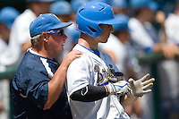 UCLA RF Chris Giovinazzo gets instruction from Coach Rick Vandershook in Game 13 of the NCAA Division One Men's College World Series on June 26th, 2010 at Johnny Rosenblatt Stadium in Omaha, Nebraska.  (Photo by Andrew Woolley / Four Seam Images)