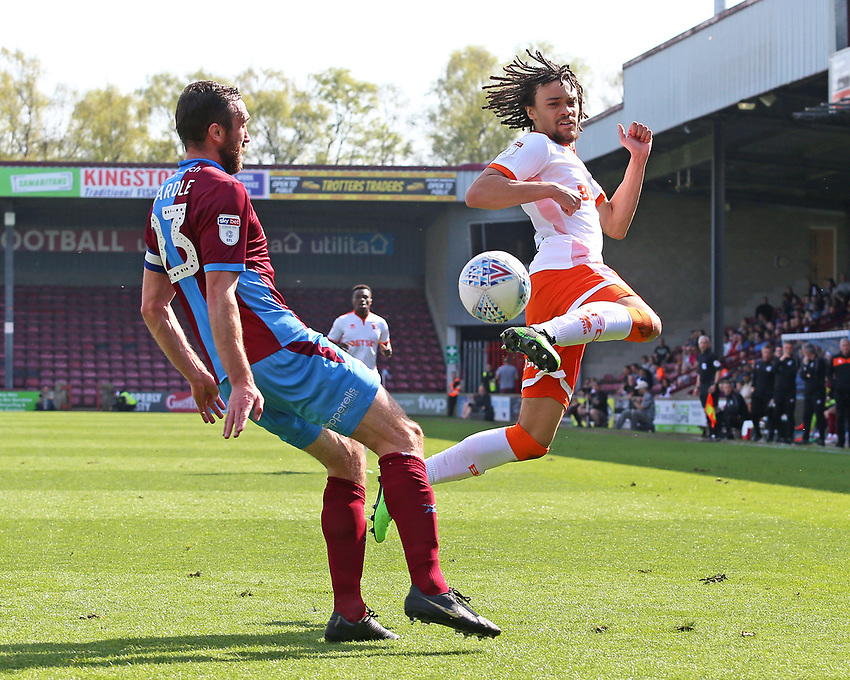 Blackpool's Nya Kirby shows a great bit of skill whilst under pressure from Scunthorpe United's Rory McArdle<br /> <br /> Photographer David Shipman/CameraSport<br /> <br /> The EFL Sky Bet League One - Scunthorpe United v Blackpool - Friday 19th April 2019 - Glanford Park - Scunthorpe<br /> <br /> World Copyright © 2019 CameraSport. All rights reserved. 43 Linden Ave. Countesthorpe. Leicester. England. LE8 5PG - Tel: +44 (0) 116 277 4147 - admin@camerasport.com - www.camerasport.com
