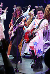The Go-Go's: Kathy Valentine and Jane Wiedlin perform during a special curtain call at Broadway's 'Head Over Heels' on July 12, 2018 at the Hudson Theatre in New York City.
