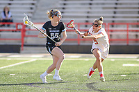 College Park, MD - April 27, 2019: John Hopkins Bluejays Ellie McNulty (55) avoids the hit during the game between John Hopkins and Maryland at  Capital One Field at Maryland Stadium in College Park, MD.  (Photo by Elliott Brown/Media Images International)