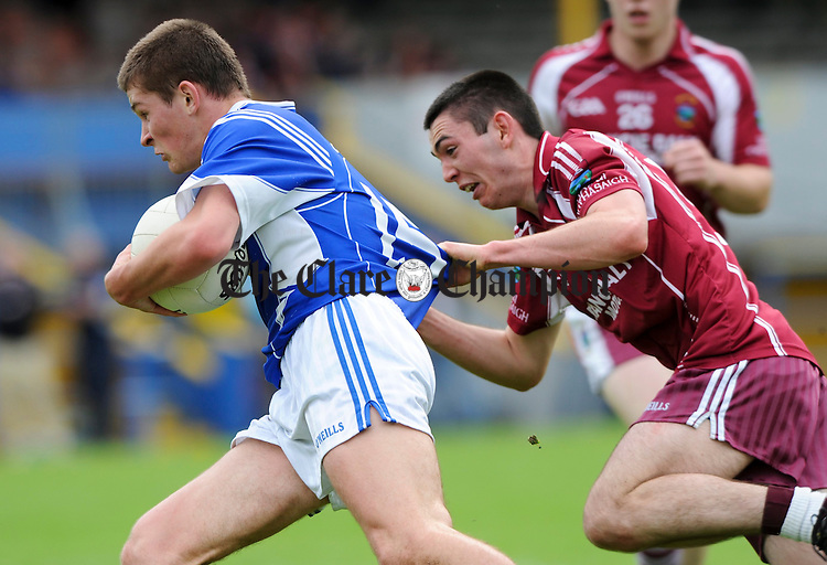 Liam Markham of Cratloe in action against Martin O Connor of Lissycasey during their game at Cusack park. Photograph by John Kelly.
