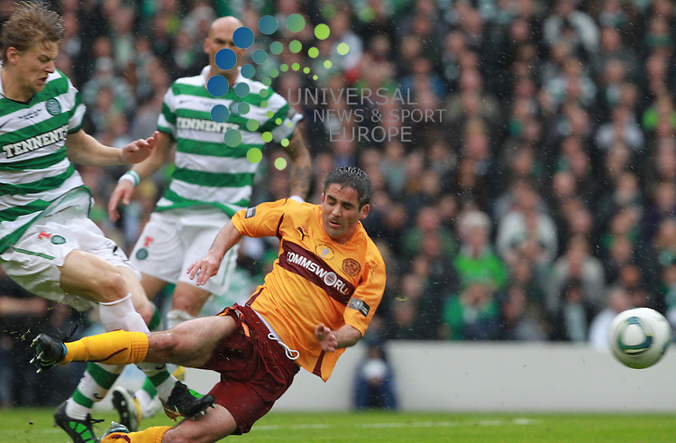 Glenn Loovens get goes in hard on Keith lasley and yellow card was given during the Motherwell FC V Celtic FC Scottish Cup Final  2011 at Hampden Park, Glasgow..Picture: Universal News And Sport (Scotland).21 May 2011...