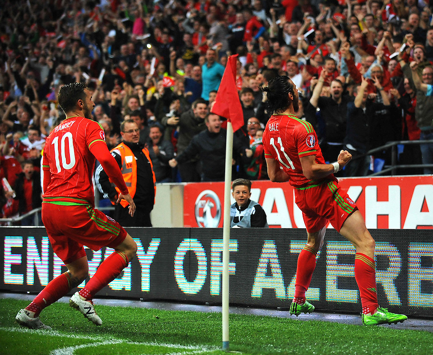 Wales' Gareth Bale celebrates scoring his sides first goal with team-mate Aaron Ramsey<br /> <br /> Photographer Kevin Barnes/CameraSport<br /> <br /> International Football - UEFA Euro 2016 Qualifying - Group B - Wales v Belgium - Friday 12th June 2015 - Cardiff City Stadium - Cardiff<br /> <br /> &copy; CameraSport - 43 Linden Ave. Countesthorpe. Leicester. England. LE8 5PG - Tel: +44 (0) 116 277 4147 - admin@camerasport.com - www.camerasport.com