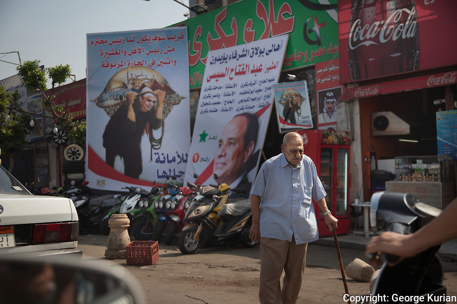 Posters of Sisi were seen all over Cairo.<br /> An old man walks past a shop front covered entirely with election propaganda.