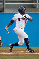 Dan Nelson #21 of the Potomac Nationals follows through on his swing versus the Winston-Salem Dash at Pfitzner Stadium June 11, 2009 in Woodbridge, Virginia. (Photo by Brian Westerholt / Four Seam Images)