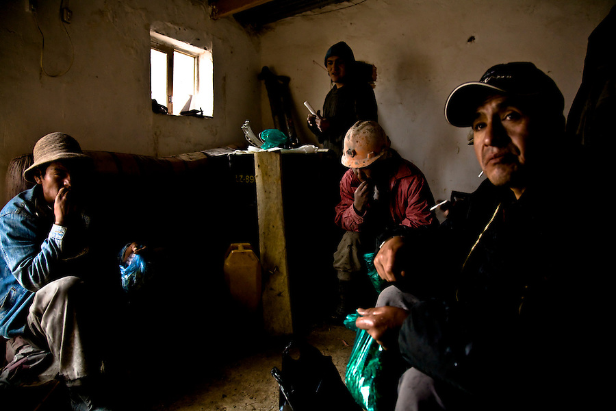 Miners resting and chewing coca leaves in a shack owned by the mining cooperative.