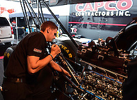 Sept. 16, 2012; Concord, NC, USA: NHRA crew member Gary Pritchett for top fuel dragster driver Steve Torrence during the O'Reilly Auto Parts Nationals at zMax Dragway. Mandatory Credit: Mark J. Rebilas-