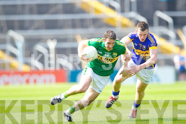 Declan O'Sullivan breaks away from Tipperary's Paddy Codd in the Munster Football Championship last Sunday in Semple Stadium, Thurles.