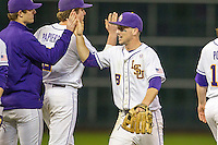LSU Tigers shortstop Alex Bregman (8) celebrates with his teammates after the the NCAA baseball game against the Houston Cougars on March 6, 2015 at Minute Maid Park in Houston, Texas. LSU defeated Houston 4-2. (Andrew Woolley/Four Seam Images)