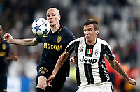 Football Soccer: UEFA Champions League semifinal second leg Juventus - Monaco, Juventus stadium, Turin, Italy,  May 9, 2017. <br /> Monaco's Andrea Raggi (l) in action with Juventus' Mario Mandzukic (r) during the Uefa Champions League football match between Juventus and Monaco at Juventus stadium, on May 9, 2017.<br /> UPDATE IMAGES PRESS/Isabella Bonotto
