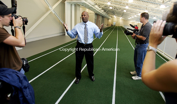 STORRS, CT. 28 August 2006--082806SV05--Vaughn Williams, associate athletic director, of UConn leads a tour through a physical training area of the Burton Family Football Complex and the Shenkman Center at the University of Connecticut in Storrs Monday.<br /> Steven Valenti Republican-American