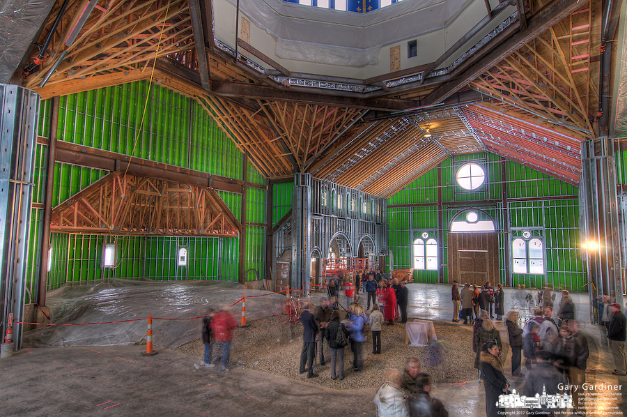 Parishioners gather at the site of the new altar for St. Paul Catholic Church in Westerville, Ohio, for ceremonies where prayers were placed beneath the location. HDR photo