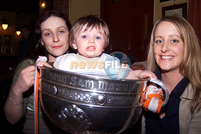 Rosslynn,(baby Noel) and Jenny Cowley, with the Sam Maguire in O'Casey's Trinity Street...Pic Newsfile