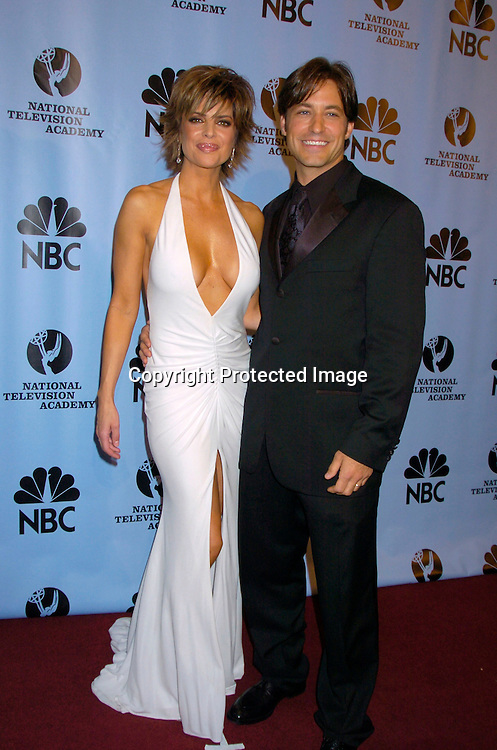 Lisa Rinna  and Ty Treadway ..at the Daytime Emmy Awards on May 21, 2004 in the Press Room at Radio City Music Hall...Photo by Robin Platzer, Twin Images