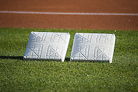 Freshly painted bases are ready to be placed as the Sacramento River Cats play the Salt Lake Bees in Pacific Coast League action at Smith's Ballpark on April 17, 2015 in Salt Lake City, Utah.  (Stephen Smith/Four Seam Images)