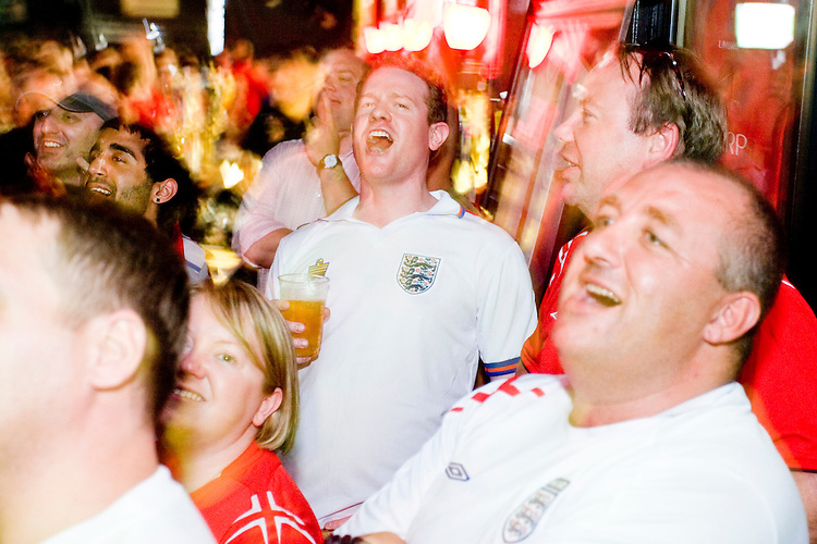England fans cheer for their team during a World Cup match with Sweden on June 20, 2006 at Nevada Smith's, a bar in New York City.<br /> <br /> The World Cup, held every four years in different locales, is the world's pre-eminent sports tournament in the world's most popular sport, soccer (or football, as most of the world calls it).  Qualification for the World Cup is open to any country with a national team accredited by FIFA, world soccer's governing body. The first World Cup, organized by FIFA in response to the popularity of the first Olympic Games' soccer tournaments, was held in 1930 in Uruguay and was participated in by 13 nations.    <br /> <br /> As of 2010 there are 208 such teams.  The final field of the World Cup is narrowed down to 32 national teams in the three years preceding the tournament, with each region of the world allotted a specific number of spots.  <br /> <br /> The World Cup is the most widely regularly watched event in the world, with soccer teams being a source of national pride.  In most nations, the whole country is at a standstill when their team is playing in the tournament, everyone's eyes glued to their televisions or their ears to the radio, to see if their team will prevail.  While the United States in general is a conspicuous exception to the grip of World Cup fever there is one city that is a rather large exception to that rule.  In New York City, the most diverse city in a nation of immigrants, the melting pot that is America is on full display as fans of all nations gather in all possible venues to watch their teams and celebrate where they have come from.