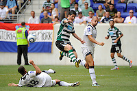 Jaime Valdes (15) of Sporting Clube de Portugal jumps over a tackle by Kyle Walker (28) of Tottenham Hotspur F. C. Tottenham Hotspur F. C. and Sporting Clube de Portugal played to a 2-2 tie during a Barclays New York Challenge match at Red Bull Arena in Harrison, NJ, on July 25, 2010.