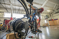 NWA Democrat-Gazette/ANTHONY REYES &bull; @NWATONYR<br /> Jack Holderby, with Monitor Elementary, attaches a front wheel to a 24-inch bike Wednesday, Aug. 12, 2015 at Sonora Elementary School in Springdale. The school purchased 32 bikes through a grant from the Walton Family Foundation for use in the school physical education department.