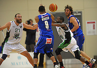 Corey Webster passes to Casey Frank during the national basketball league match between Wellington Saints and Manawatu Jets at TSB Bank Arena, Wellington, New Zealand on Tuesday, 7 May 2013. Photo: Dave Lintott / lintottphoto.co.nz
