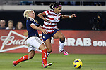 09 February 2012: Sydney Leroux (USA) (14) and Rhonda Jones (SCO) (left). The United States Women's National Team played the Scotland Women's National Team at EverBank Field in Jacksonville, Florida in a women's international friendly soccer match. The U.S. won the game 4-1.