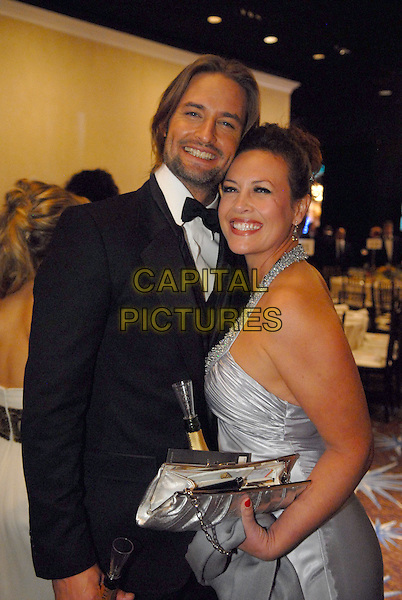 "JOSH HOLLOWAY & GUEST.Telecast - 64th Annual Golden Globe Awards, Beverly Hills HIlton, Beverly Hills, California, USA..January 15th 2007. .globes half length silver halterneck dress black tuxedo clutch purse.CAP/AW.Please use accompanying story.Supplied by Capital Pictures.© HFPA"" and ""64th Golden Globe Awards"""