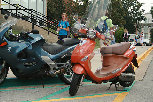Duy Tran a chemistry senior climbs aboard mo-ped outside the chemistry physics building Tuesday afternoon. Photo by LeeAlan Yates | Staff.