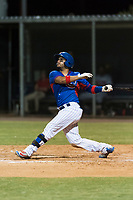 AZL Cubs 2 catcher Richard Nunez (2) follows through on his swing during an Arizona League game against the AZL Indians 2 at Sloan Park on August 2, 2018 in Mesa, Arizona. The AZL Indians 2 defeated the AZL Cubs 2 by a score of 9-8. (Zachary Lucy/Four Seam Images)