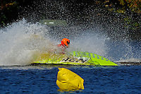 Frame 6: 24-J and 48-N  race into the turn, 48-N then catches the wake a spins out at speed. (runabout)
