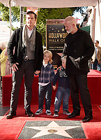 HOLLYWOOD, CALIFORNIA - DECEMBER 4: (L-R) David Miller and Ryan Murphy with  their sons Logan Phineas and Ford, attend a ceremony honoring Ryan Murphy with a star on The Hollywood Walk of Fame on December 4, 2018 in Hollywood, California. (Photo by Frank Micelotta/Fox/PictureGroup)