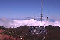 Weather station on Hualalai volcano summit area and Maui in the distance The Big Island of Hawaii