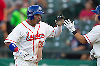 Wearing an Austin Senators throwback uniform, Round Rock Express designated hitter Manny Ramirez (39) after he scored during the Pacific Coast League baseball game against the Oklahoma City RedHawks on July 9, 2013 at the Dell Diamond in Round Rock, Texas. Round Rock defeated Oklahoma City 11-8. (Andrew Woolley/Four Seam Images)
