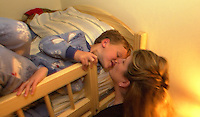 Oct 21, 2004 - PLEASANTON, California, USA - 7:49 PM: Aleks Twarowski, 6, gets a kiss good night from his mother Shelly in his bunk bed in Pleasanton, Calif., Thursday Oct. 21, 2004. Aleks and Shelly shared a brief exchange in French at bedtime after he spent time reading books with his father..(Credit Image: © Alan Greth)