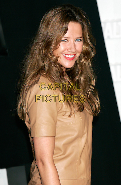 "ALEXANDRA NELDEL.""Salt"" German Film Premiere held at the .Sony Center, Berlin, Germany,.August 18th, 2010..half length beige leather smiling red lipstick .CAP/PE.©Peter Eden/Capital Pictures."