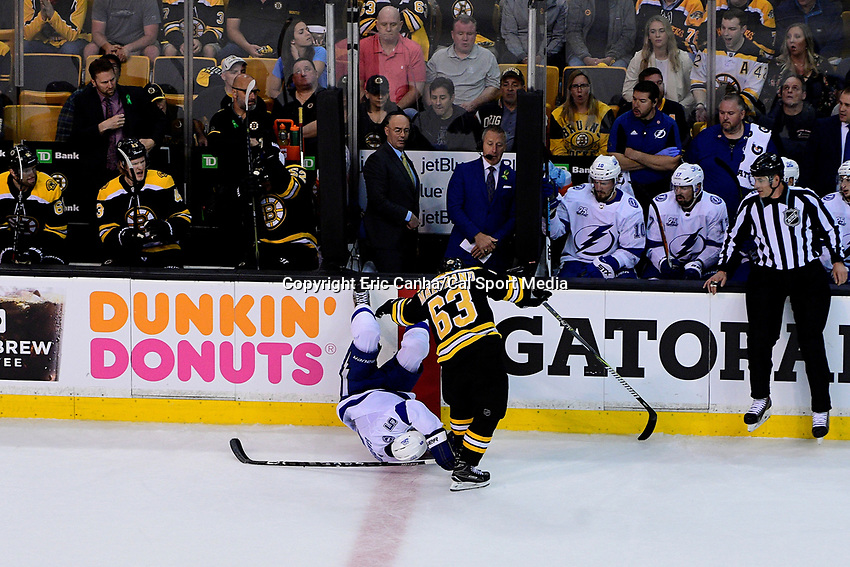 May 2, 2018: Boston Bruins left wing Brad Marchand (63) upends Tampa Bay Lightning defenseman Dan Girardi (5) during game three of the second round of the National Hockey League's Eastern Conference Stanley Cup playoffs between the Tampa Bay Lightning and the Boston Bruins held at TD Garden, in Boston, Mass. Tampa Bay defeats Boston 4-1. Eric Canha/CSM