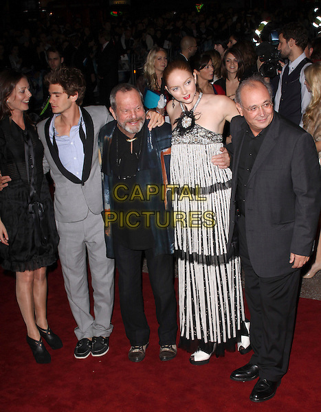 """AMY GILLIAM, ANDREW GARFIELD, TERRY GILLIAM, LILY COLE & GUEST.The UK Premiere of """"The Imaginarium Of Doctor Parnassus"""" at the Empire Leicester Square, London, England.  .October 6th, 2009 .full length red lipstick beaded beads  embellished jewel encrusted black white seashells shells grey gray suit jacket profile beard facial hair long maxi striped stripes.CAP/AH.©Adam Houghton/Capital Pictures."""
